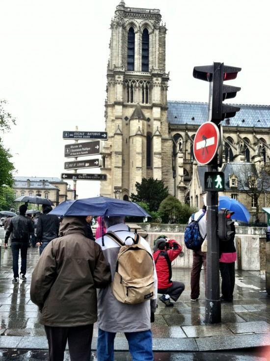 Green alien crosswalk signs in Paris, France