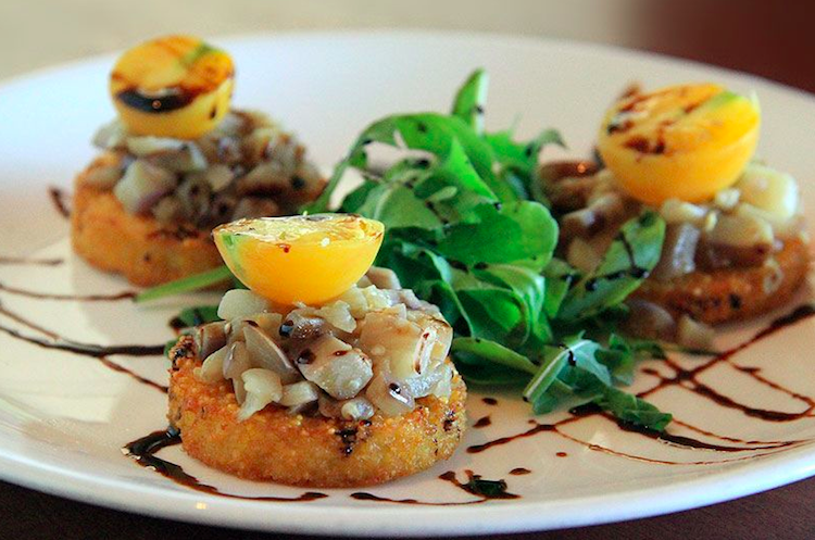 Crispy Polenta with Sauteed Eggplant Arugula and Peach Tomato with a balsamic reduction